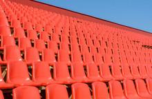 Spectator Bleachers On An Open Soccer Field. Stadium For Summer Football Matches. Outdoor Stadium