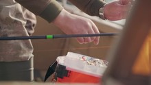 Fisherman Vibrates In The Box Spinning Bait Close-up In Slow Motion