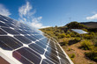 canvas print picture - Close up wide angle view of photovoltaic solar panels on an off the grid electricity instalation on a farm in the Karoo outside Touwsrivier in the western cape of south africa
