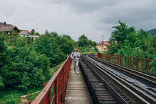 Handsome Man With Camera On Forest Background. Man On Railroad Track