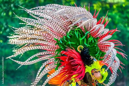 Obraz Closeup shot of the colorful feathers of a traditional Native Indian-American festive regalia - fototapety do salonu