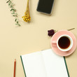 Work and study place. note book, cup of coffee, smart phone with floral decoration. flat lay, top view, copy space