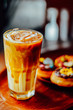 Iced caramel latte coffee in a tall glass on wood table , The drink menu . cafe image