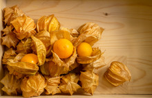 Yellow Ripe Cape Gooseberry Fruit In A Brown Wooden Box Know As Goldenberry Or Physalis, Top View Image