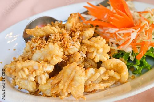 Fototapeta Deep fried squid with garlic - Thai style obraz