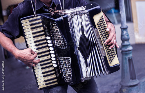 Fototapeta musician playing accordion music on street show performance