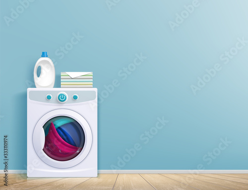 Obraz Washing machine in the room in front of the wall. - fototapety do salonu