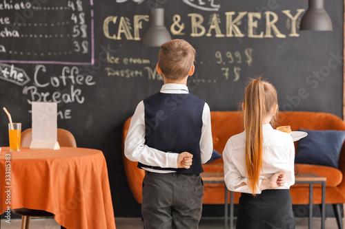 Fototapeta Cute little waiters in restaurant