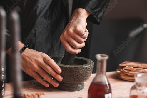 Fototapeta Male alchemist making elixir in laboratory, closeup obraz