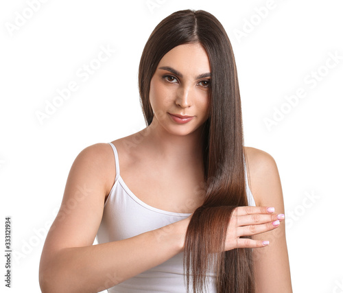 Fototapeta Young woman with beautiful straight hair on white background