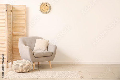Fototapeta Interior of modern room with comfortable armchair