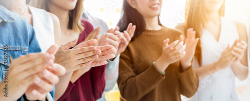 Fototapeta Portrait of partners clapping hands in business seminar