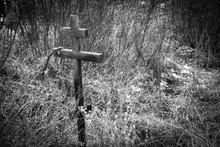 Funeral Christian Cross On Birch And Sky Background, Front And Background Blurred With Bokeh Effect