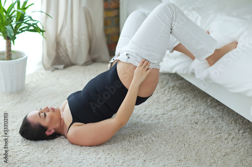 Fototapeta Overweight woman. A young woman cannot put on her pants, obesity.  obraz