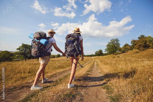 Fototapeta Hiking couple with backpack walking on hike in nature obraz