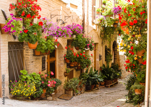 Fototapety, obrazy: Medieval street of Spello decorated with flowers