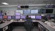 A worker sits in front of many monitors. Production room. Monitoring of technical processes in oil production.