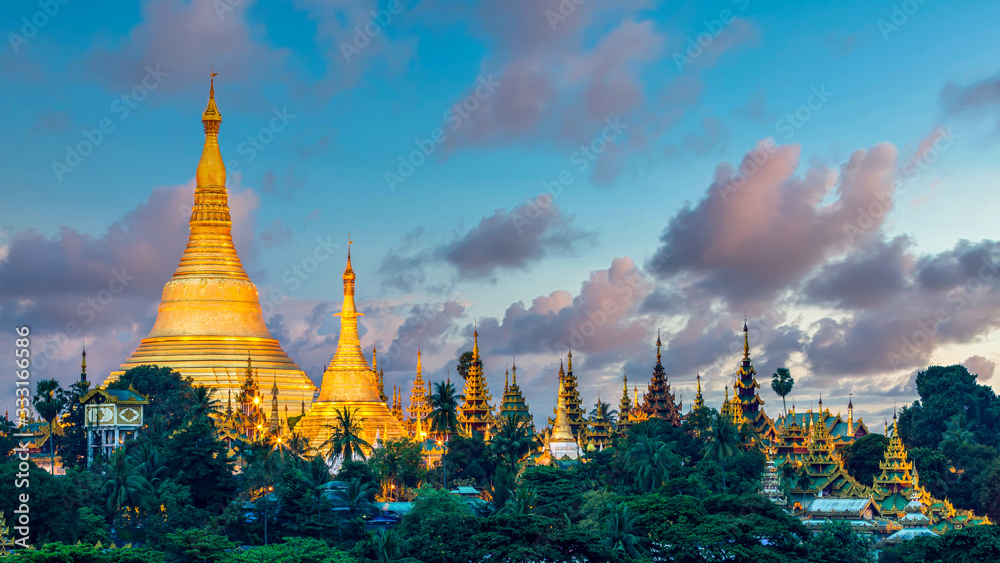 Fototapeta Shwedagon Pagoda attraction in Yagon City with blue sky background, Shwedagon Pagoda ancient architecture is beautiful pagoda in Southeast Asia, Yangon, Myanmar, Asian, Asia.