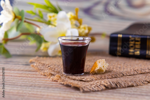 Fotografie, Obraz Taking communion and Lord Supper concept with Holy Bible