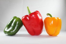Three Peppers Isolated On White Background