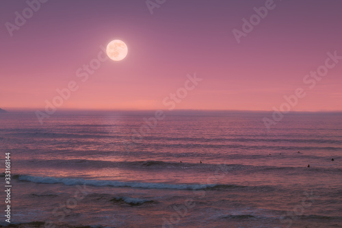seascape with full moon on the sea at twilight