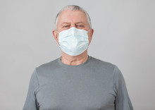 Senior In Medical Mask Isolate...