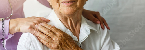 Cuadros en Lienzo Elderly female hand holding hand of young caregiver at nursing home