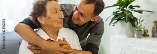 Obraz Grandson visiting grandmother - fototapety do salonu