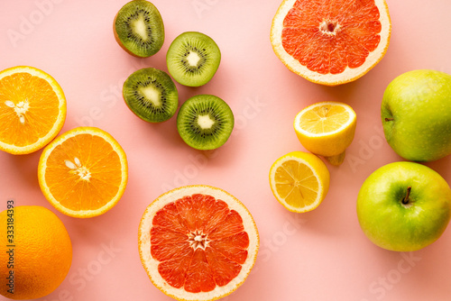 Fototapeta Fruits rich in vitamin C on a pink background obraz