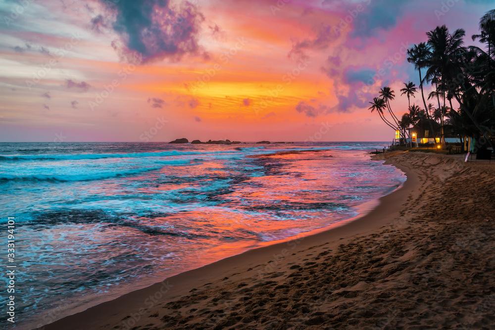 Fototapeta beautiful tropical sunset and beach