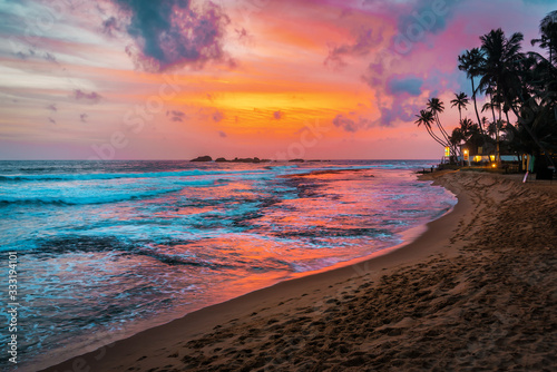 Fototapeta beautiful tropical sunset and beach obraz