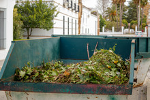 Metal Skip Filled With Green Waste On The Road In Llerena Spain