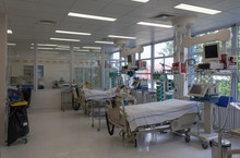 Intensive Care Unit In Hospital, Beds With Monitors, Ventilators, A Place Where Can Be  Treated Patients With Pneumonia Caused By Coronavirus Covid 19.