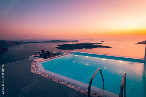 Fototapeta Amazing sunset relaxing mood the pool in a luxurious hotel resort at sunset enjoying perfect beach holiday vacation