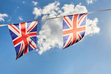 British Union Jack Bunting Flags Against Sky