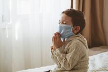 Coronavirus Covid-19. Child Praying To God Requesting That The Coronavirus Covid 19 Not Spread Beyond Control.