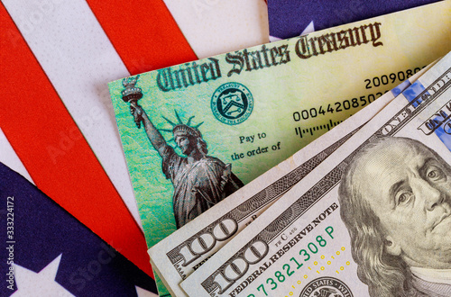 Fototapeta COVID-19 on global pandemic lockdown, stimulus package financial package government for people American flag US dollar cash banknote obraz