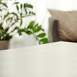 Table background of free space and blurred home interior.