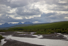 Mountain Landscape With River And Clouds In Denali National Park And Preserve In Alaska