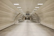 canvas print picture - Underground subway station hallway tunnel with escalator. Abstract perspective view