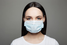 Young Woman In Mask. Medical Masked Beautiful Girl