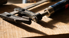 Clamp Tool On A Wooden Backgro...