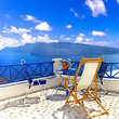 Romantic greek holidays in most beuatiful island Santorini. coffe table with gorgeous caldera and volcano view