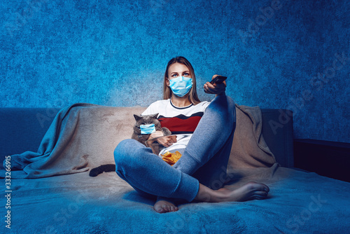 the woman and the cat on the couch in front of the TV are both in protective med Wallpaper Mural