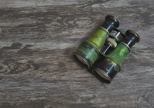 Flat Lay A Pair Of Vintage Military Binoculars In A Grunge Brown Background With Copy Space