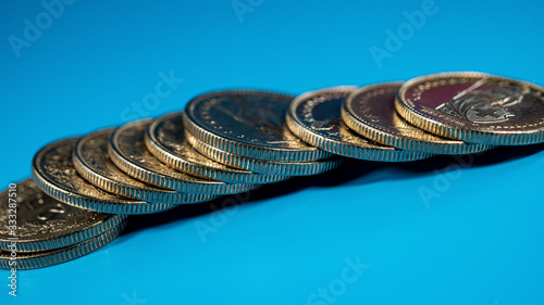 Fototapeta stack of Swiss coins in denominations of two francs lie on a blue background