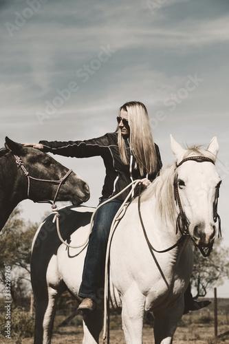 Photo Woman riding gray mare horse bareback while ponying, western farm lifestyle