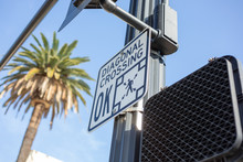 A View Of A Public Street Traffic Sign To Inform Pedestrians That This Intersection Has A Diagonal Crosswalk.