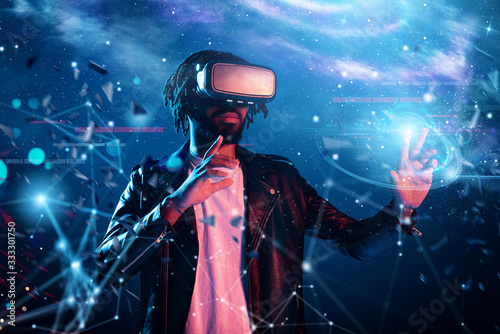Fotomural Boy with VR glasses play with a virtual videogame