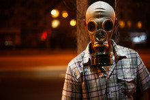 Man In A Gas Mask On Night Str...